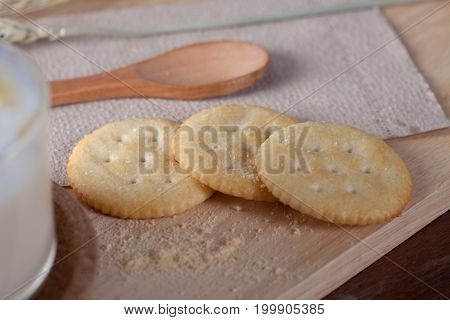 Close Up Biscuits With Hot Milk On Wooden Plate On Wooden Table For Breakfast.