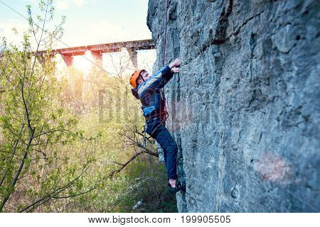 Kid Rock Climber Climbs The Cliff.