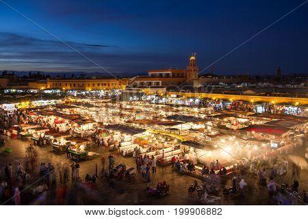 Jamaa el Fna market square at dusk, Marrakesh, Morocco, north Africa. Jemaa el-Fnaa, Djema el-Fna or Djemaa el-Fnaa is a famous square and market place in Marrakesh's medina quarter.