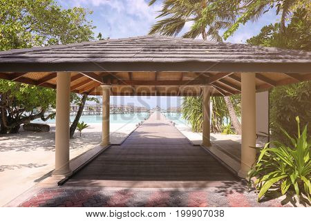 Shelter shed and pontoon bridge at tropical resort