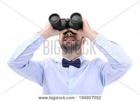 Handsome young man with binocular on white background