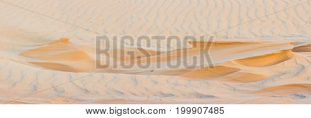 close-up of beautiful sunlit sand in desert