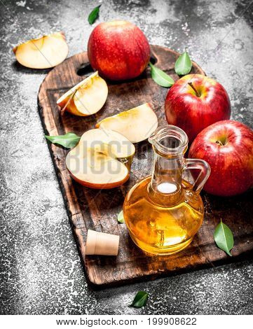 Apple Cider Vinegar With Fresh Apples On Cutting Board.