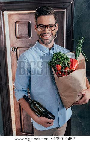 Happy Handsome Young Man Arrived From Grocery Store