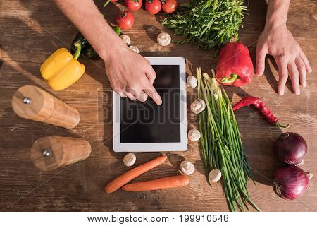 Top View Of Young Man Cooking With Tablet And Pointing At Blank Screen