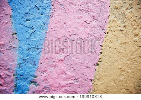 Grunge Background. Wall with the colored turquoise whitewash falling off fragment as a background texture