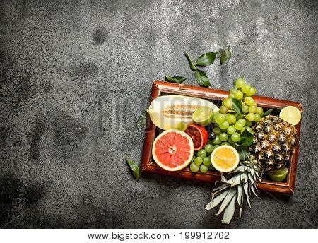 Ripe Fruits In The Old Tray.