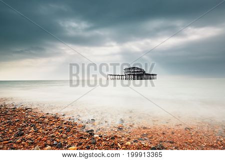 Abandoned (after fire) West pier in Brighton in gloomy day United Kingdom
