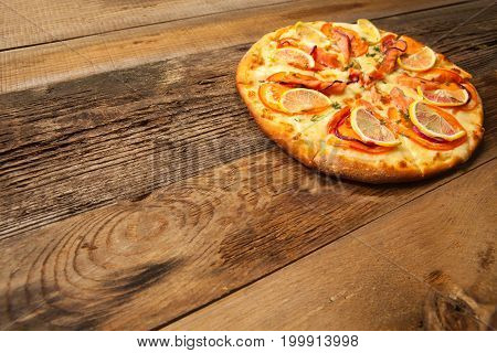 Salmone Pizza On Wooden Table.