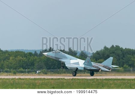 MOSCOW, RUSSIA - JULY, 2017: Russian Air Force twin engine Sukhoi T-50 5th PAK FA generation stealth fighter bomber war plane flying aerial detail exterior side flat view