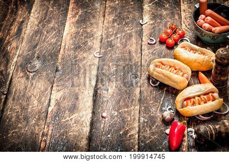 Street Food. Fresh Hot Dogs With Peppers, Onions And Tomatoes.