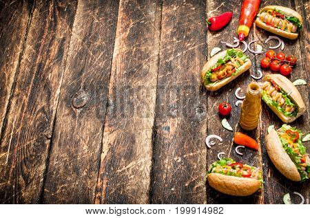 Street Food. Hot Dogs With Mustard, Hot Sauce , Onion And Greens.