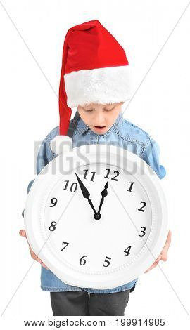 Cute little girl in Santa hat with clock on white background. Christmas countdown concept