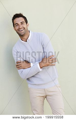 Laughing guy in sweater looking at camera