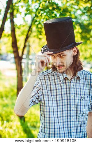 Guy in a hat in the nature