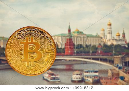 Photo Golden Bitcoins (new virtual money. Coins bitcoin in the background of Moscow. Conceptual photo.