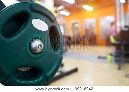 Closeup of weight equipment in modern fitness center. Gym background. Shallow depth of field.