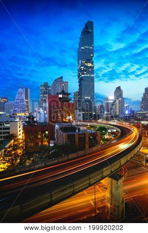 BTS skytrain and Mahanakhon building in background at silom road Bangkok Thailand