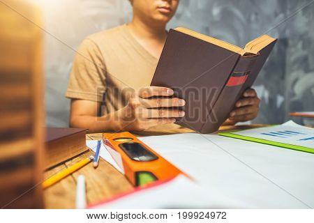 A Man Reading A Book, Vintage Tone Style Of Picture.