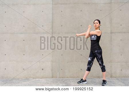 Girl Standing On Gray Wall Outdoor Walkway