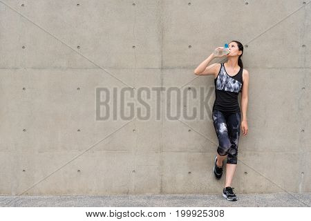Exercise Woman Drinking Water After Jogging