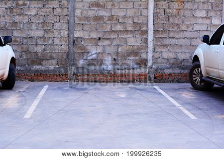 free lane car parking with old wall