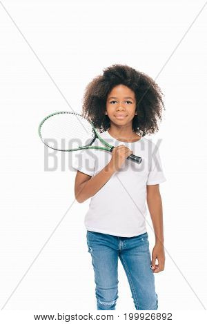 adorable african american girl holding tennis racquet and smiling at camera isolated on white