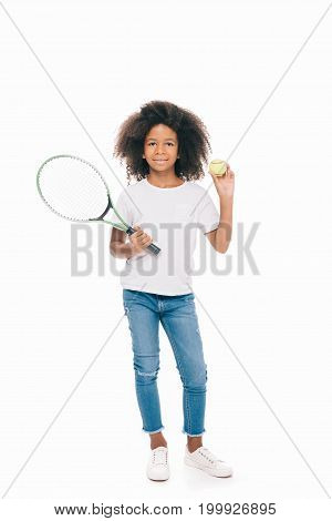 cute smiling african american girl holding tennis racquet with ball isolated on white