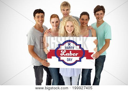 Group of teenagers holding a blank card against digital composite image of happy labor day banner