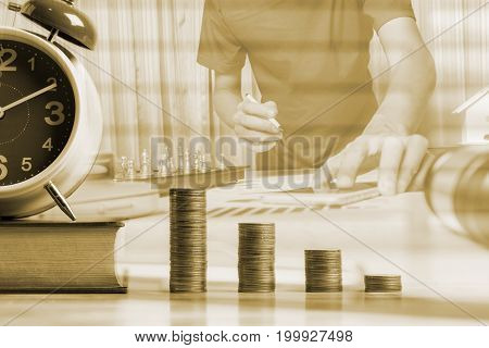 Saving money for education and loan for study concept in modern room wooden table.