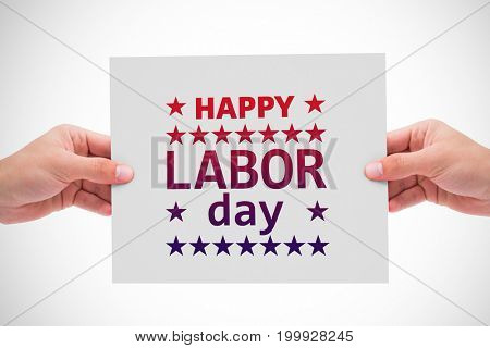 Hand showing card against poster of happy labor day text