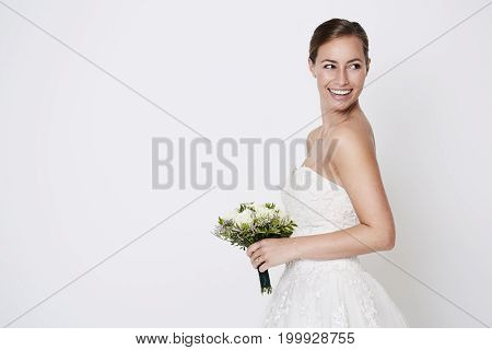 Happy bride about to throw bouquet studio