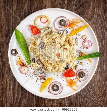 Alfredo pasta - spaghetti with olives chicken cream sauce