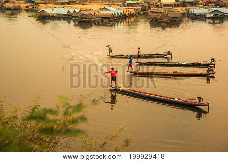 Ubonratchathani Thailand-April 30 2016: Fishermen using net to catch fishes in the river in Ubonratchathani Thailand