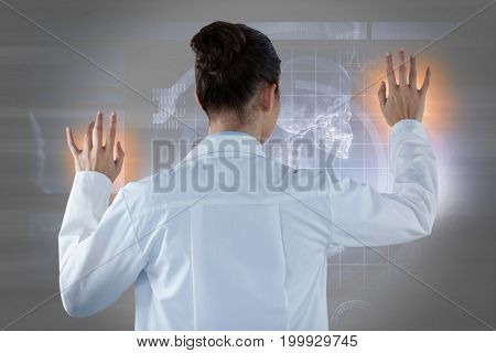 Female doctor using digital screen against white background against gray abstract image