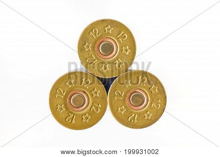 Three cartridges of 12th caliber for a hunting rifle.