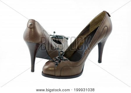 Brown women's shoes with black laces on a white background.