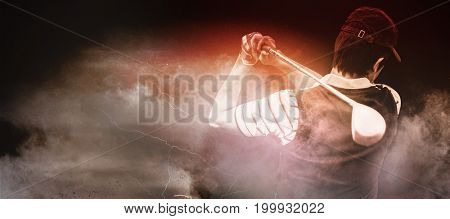 Man playing golf against digitally generated image of color powder