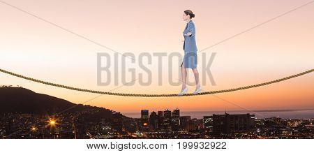 Businesswoman walking with arms outstretched over white background against view of the city by night