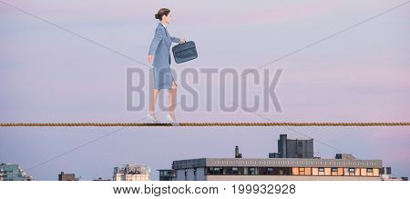 Businesswoman walking with briefcase over white background against city against sky during sunset