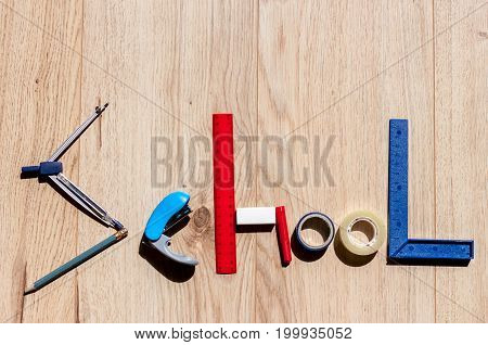 word school made of stationery on woden background
