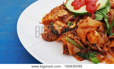 View of fried hot and spicy flat noodles or known as kuey tiaw