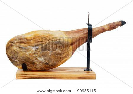 Whole jamon on a wooden stand isolated on white background