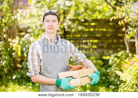 Man in gloves holding carrots