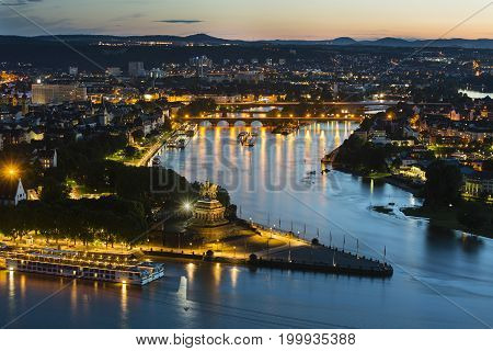 View of Deutsches Eck and the oldtown of Koblenz Germany with Rhine and Moselle River in the night.