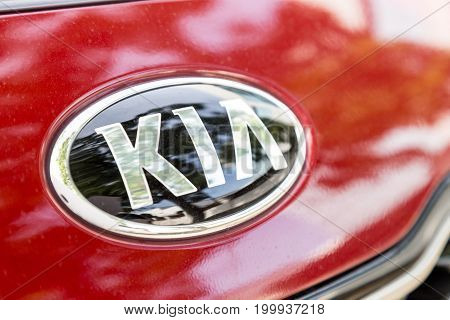 KUALA LUMPUR MALAYSIA - August 12 2017: Kia Motor Corporation headquartered in Seoul is South Korea's second-largest automobile manufacturer with sales of over 3.3 million vehicles in 2015.  Picture here is the latest emblem of Kia.