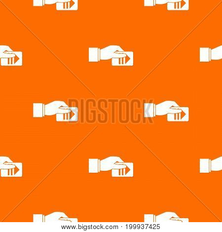 Hand with parking ticket pattern repeat seamless in orange color for any design. Vector geometric illustration