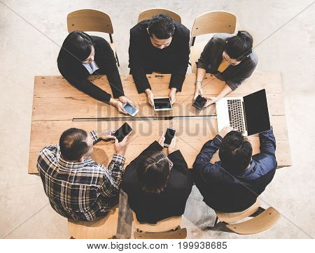Top View Business team using tablet computer to work with financial data. Partners discussing graph of report growth. Business Concept.
