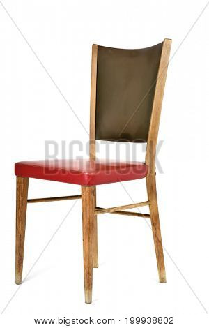 an old chair upholstered in leatherette of different colors, red and green, on a white background