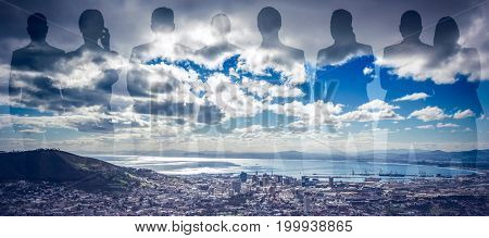 Colleagues on white background against landscape of city and cloudy sky
